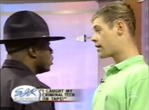 Sgt. Julu gets up close and personal with an unruly teen on The Sally Jessy Raphael Show.